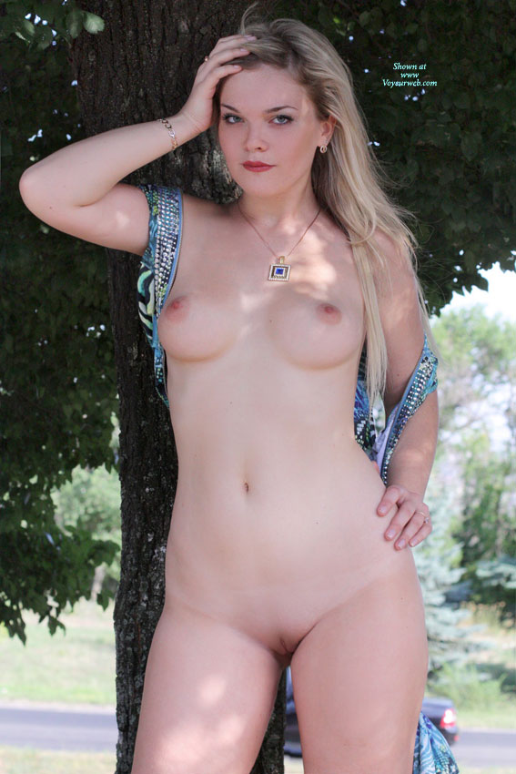Nude shaved girl standing