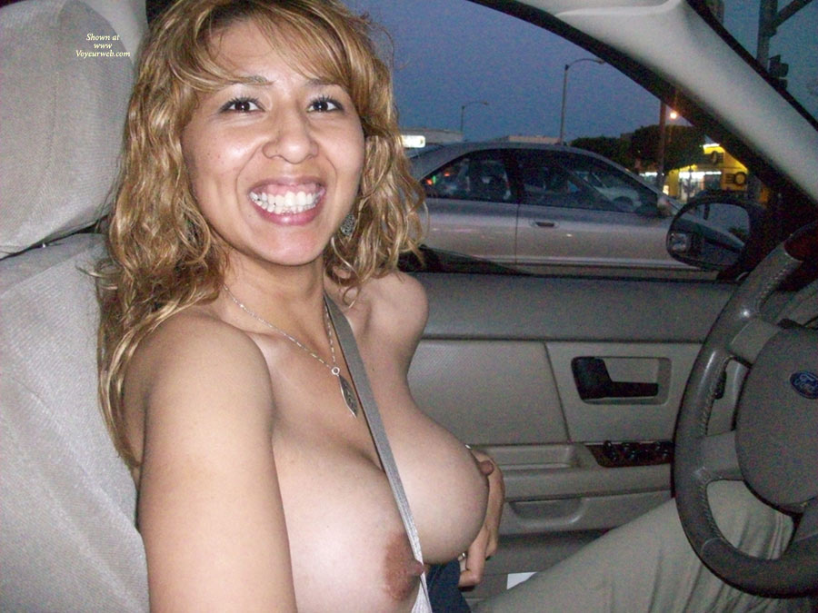 Huge tits naked in the car